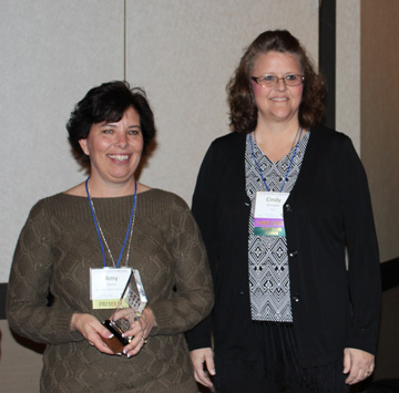 Photo of Amy Owens holding her award with Cindy Schroeder
