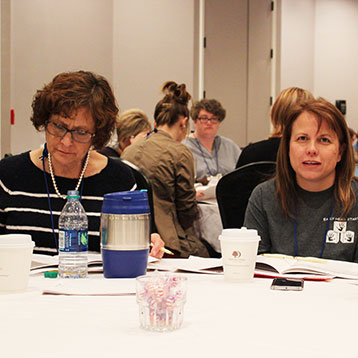 conference  participants at presentation