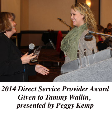 photo of Tammy Wallin receiving award from Peggy Kemp